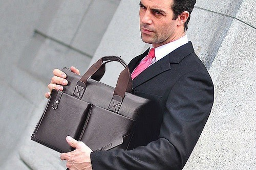 Bussinesman Holding Messenger Bag