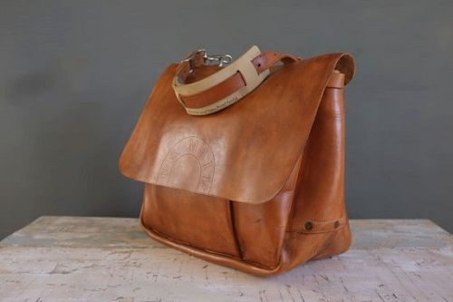 Leather Mail Bag On Table